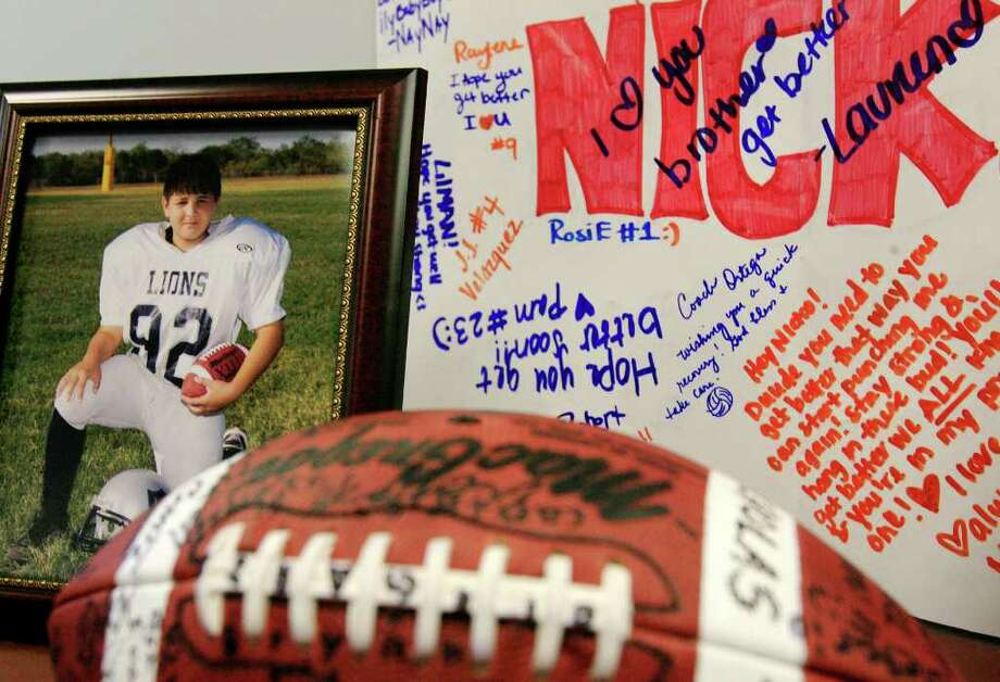 A photo of Nicholas Tijerina, 13, is displayed with messages from his friends as this family held a news conference Friday Dec. 16, 2011 at McAllen Medical Center in McAllen, Texas. Nicholas was one of two students who was shot in by a stray bullet while trying out for the basketball team on Monday at Harwell Middle School in Edinburg. Photo: AP