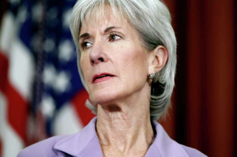FILE - In this Oct. 31, 2011 file photo, Health and Human Services Secretary Kathleen Sebelius is seen in the Oval Office at the White House in Washington. The Obama administration is rolling out a health benefits framework for millions of Americans who will get private insurance through the health care overhaul _ and states get to decide the specifics. (AP Photo/Charles Dharapak, File) Photo: Charles Dharapak / AP