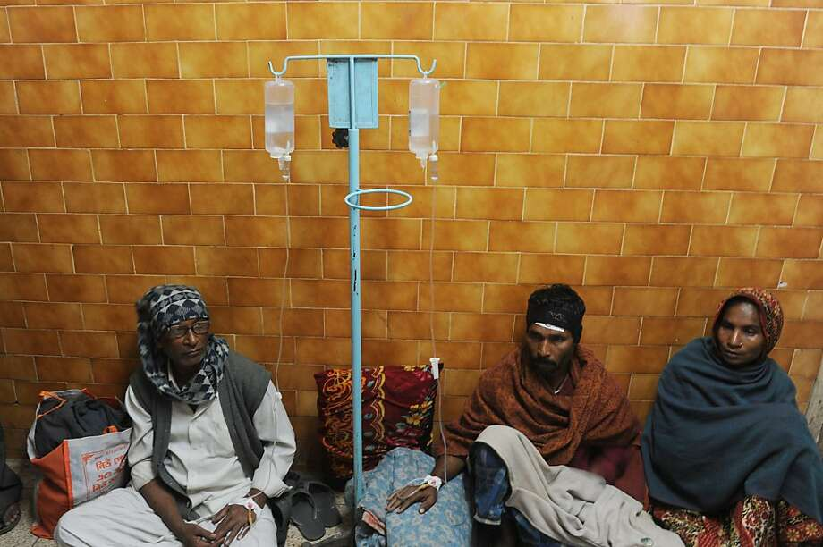 Alcohol poisoning patients receive medical treatment at the Diamond Harbour sub-divisional hospital in Diamond Harbour, after dozens died and many injured drinking boot-leg liquor in several villages south of Kolkata, on December 15, 2011. A batch of home-brewed liquor thought to have been laced with the highly toxic chemical methanol has killed 131 people in eastern India, an official told AFP. Many of them were labourers and rickshaw drivers too poor to afford branded alcohol who stopped for a drink at illegal bars or bought from bootleggers after work on Tuesday. AFP PHOTO/Dibyangshu SARKAR (Photo credit should read DIBYANGSHU SARKAR/AFP/Getty Images) Photo: Dibyangshu Sarkar, AFP/Getty Images