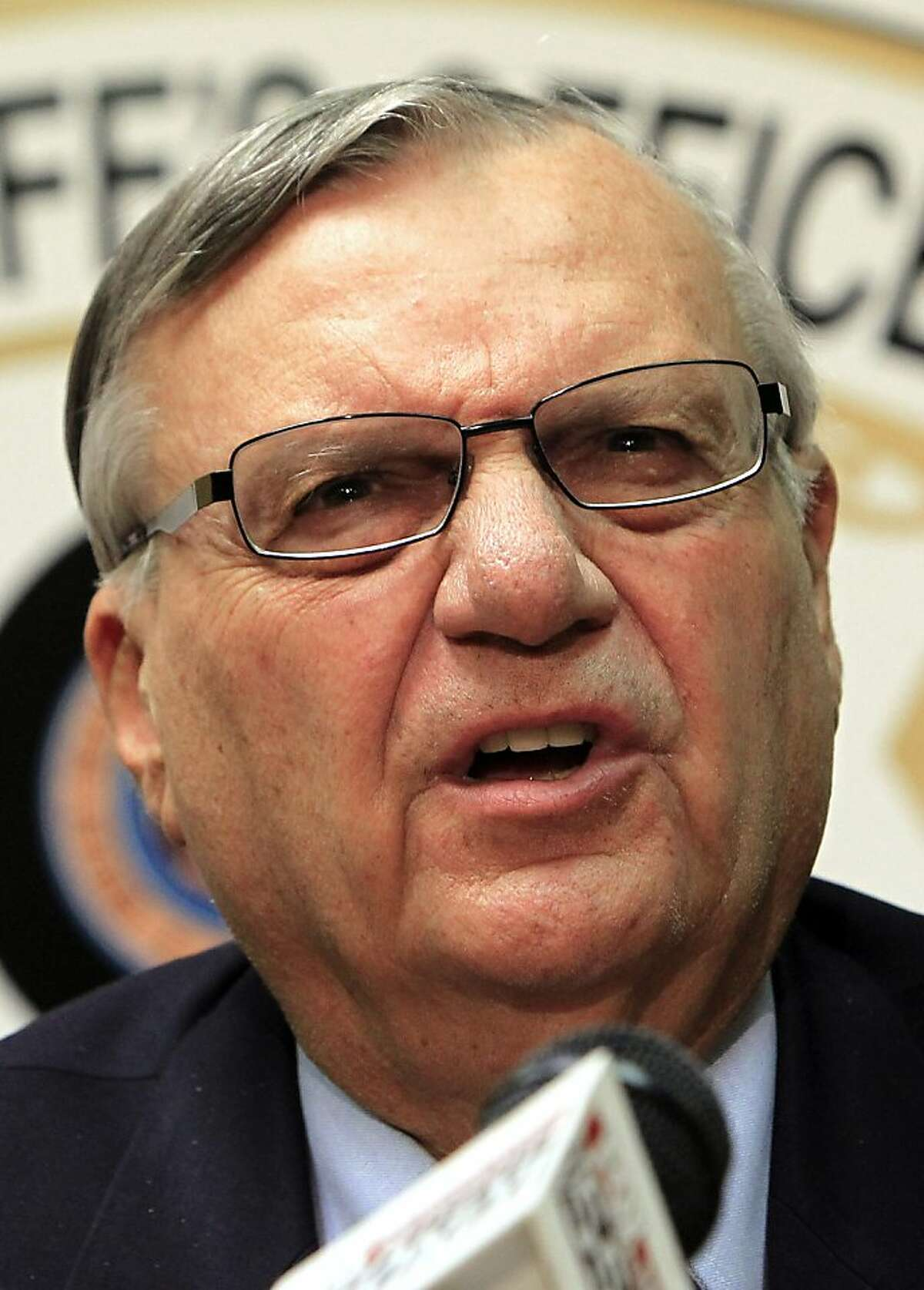 FILE - In a Monday, Dec. 5, 2011 file photo, Maricopa County Sheriff Joe Arpaio discusses the latest in the document release on his office's handling of many sexual assault cases over the years in El Mirage, Ariz., during a news conference, in Phoenix. Federal authorities plan to announce their findings Thursday, Dec. 15, 2011 in a civil rights investigation of Arpaio, who has been accused of using discriminatory tactics in its signature immigration patrols. (AP Photo/Ross D. Franklin, File)