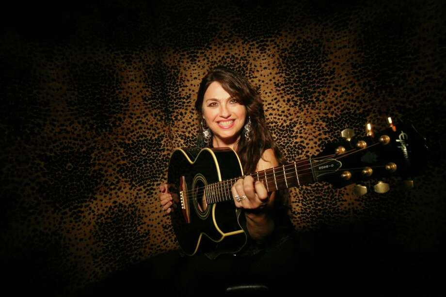 Guitarist Norma Zenteno photographed at Sambuca Restaurant and Bar on Thursday, July 31, 2008 in Houston, Tx.  Photo by Mayra Beltran / Chronicle Photo: Mayra Beltran / Houston Chronicle