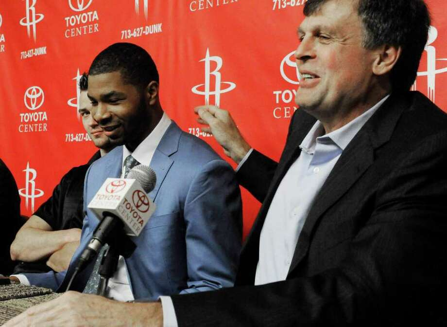 Houston Rockets basketball coach Kevin McHale, right, introduces the team'  first round NBA draft pick Kansas forward Marcus Morris during a news conference, Friday, June 24, 2011, in Houston. (AP Photo/Pat Sullivan) Photo: Pat Sullivan / AP