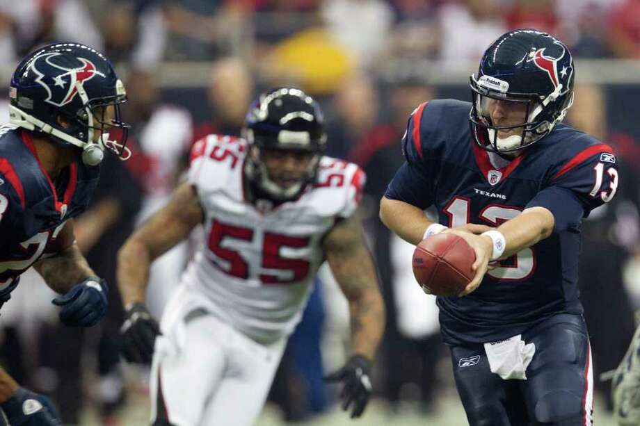 Houston Texans quarterback T.J. Yates (13) hands the ball off to running back Arian Foster (23) during the first quarter of an NFL football game against the Atlanta Falcons at Reliant Stadium on Sunday, Dec. 4, 2011, in Houston. ( Smiley N. Pool / Houston Chronicle ) Photo: Smiley N. Pool / © 2011  Houston Chronicle