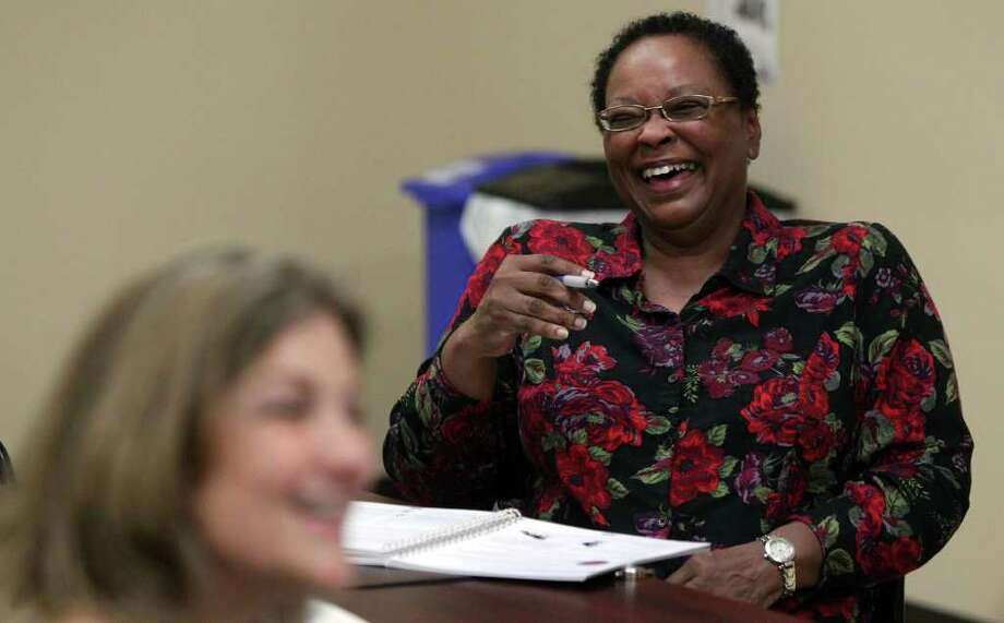 Caregiver Pat Johnson (right) shares in a light moment during a meeting and discussion held Monday October 24, 2011 at the WellMed resource center on Culbra road. The WellMed Charitable Foundation developed a program called Caregiver SOS to offer training and support to family caregivers whose loved ones have been impacted by Alzheimer's disease and chronic conditions such as stroke, diabetes and more. On the left is Caregiver Specialist Joye McQueen. Photo: SAN ANTONIO EXPRESS-NEWS