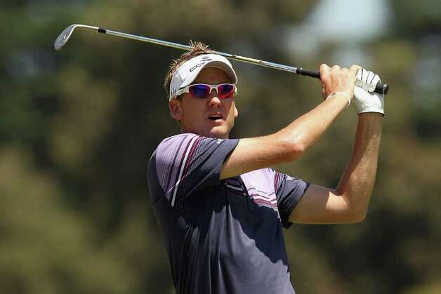 MELBOURNE, AUSTRALIA - DECEMBER 16:  Ian Poulter of England plays an approach shot during day two of the 2011 Australian Masters at The Victoria Golf Club on  December 16, 2011 in Melbourne, Australia. Photo: Quinn Rooney, Getty Images / 2011 Getty Images