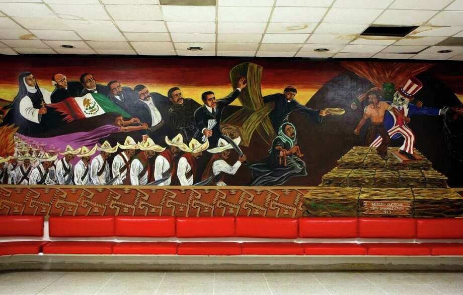 A Chicano-themed mural sits in the Cougar Den. Photo: Johnny Hanson / © 2011 Houston Chronicle