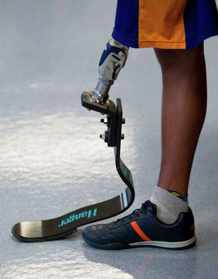 Alan Sanchez, 17, of Monterey, Mexico, answers questions for the media as he wears a new above knee prosthetic designed for running. Photo: Nick De La Torre, Houston Chronicle / © 2011  Houston Chronicle