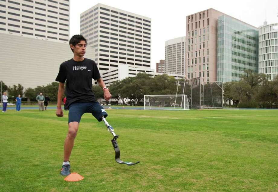 Alan Sanchez, 17, of Monterey, Mexico, tries out a new above knee prosthetic designed for running at Rice University's Wendel D. Ley track in Houston. Sanchez received the leg from Hangar and Shriners Hospital. Sanchez lost his leg when he was five and was using a coaches prosthetic to play sports. Photo: Nick De La Torre, Houston Chronicle / © 2011  Houston Chronicle