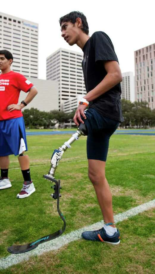 Alan Sanchez, 17, of Monterey, Mexico, tries out a new above knee prosthetic designed for running. Photo: Nick De La Torre, Houston Chronicle / © 2011  Houston Chronicle