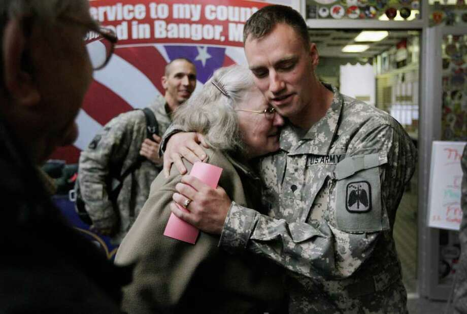 BANGOR, MAINE - DECEMBER 16:  U.S. Army Specialist Cory Davis from Somersworth, New Hampshire of the 1st 229 16th Cav. is greeted by his grandmother Christina Davis as he arrives in Maine for a refueling stop as they make their way to Fort Hood, Texas after being one of the last American combat units to exit from Iraq on December 16, 2011 in Bangor, Maine. The U.S. military formally ended its mission in Iraq after eight years of war and the overthrow of Saddam Hussein.  (Photo by Joe Raedle/Getty Images) Photo: Joe Raedle / 2011 Getty Images