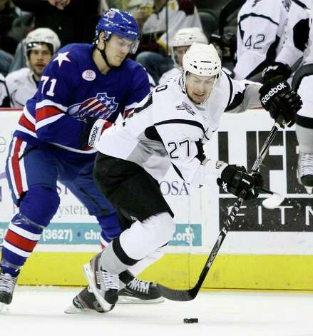 Rampage forward Greg Rallo (right) dodges Rochester's Marcus Foligno during the first period. Photo: Darren Abate, Darren Abate/pressphotointl.com / Darren Abate/pressphotointl.com