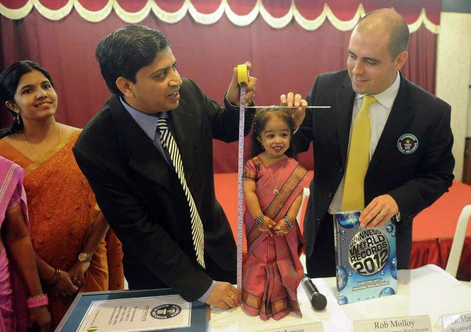 "Guinness World Records Adjudicator Rob Molloy (R) and doctor Manoj Pahukar (2nd L) measure Jyoti Amge (C), 18, during a news conference in Nagpur on December 16, 2011. Amge was officially announced by the Guinness World Records on December 16 the world's ""shortest woman living (mobile)"" measured as 62.8cm (24.7 inches) and will take the title from US woman Bridgette Jordan, previously held the record at 69.5 cm (27.4 in). Photo: PUNIT PARANJPE, Getty / AFP"