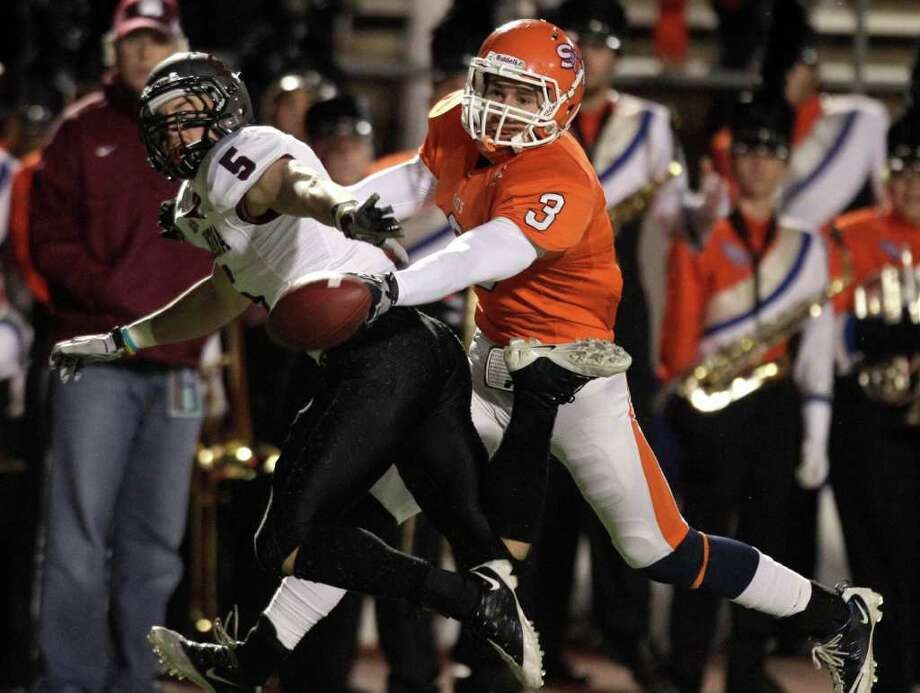 Montana cornerback Donny Lisowski (5) breaks up a pass intended for Sam Houston State wide receiver Grant Merritt (3) during the second quarter of an NCAA Football Championship Subdivision semifinal playoff game at Bowers Stadium Friday, Dec. 16, 2011, in Huntsville. Photo: Brett Coomer, Houston Chronicle / © 2011 Houston Chronicle