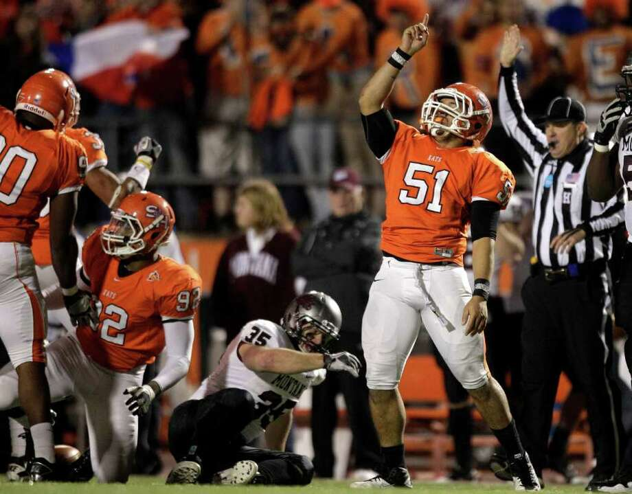 Sam Houston State linebacker Eric Fieilo (51) reacts after stopping Montana running back Dan Moore (35) for a loss during the first quarter of an NCAA Football Championship Subdivision semifinal playoff game at Bowers Stadium Friday, Dec. 16, 2011, in Huntsville. Photo: Brett Coomer, Houston Chronicle / © 2011 Houston Chronicle