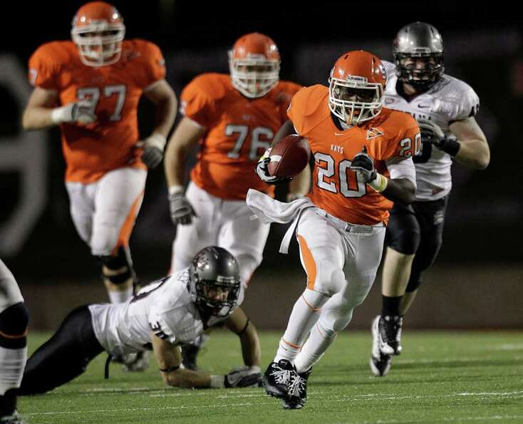 Sam Houston State running back Tim Flanders (20) breaks away from Montana safety Bo Tulley (30) on h