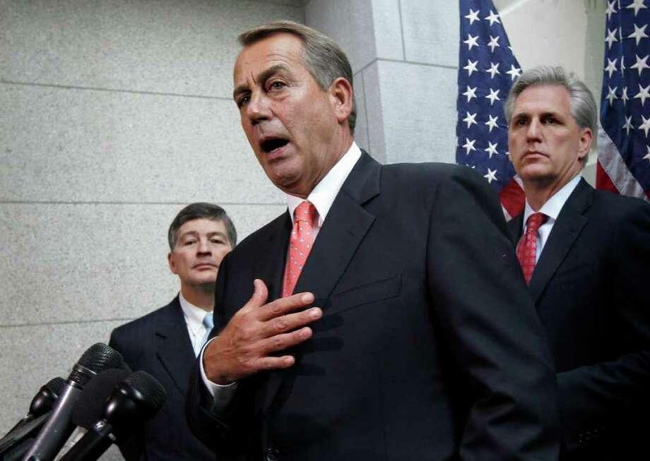 J. SCOTT APPLEWHITE : ASSOCIATED PRESS  NO HOLIDAY YET: House Speaker John Boehner, flanked by Rep. Jeb Hensarling, R-Texas, left, and Majority Whip Kevin McCarthy, R-Calif., have more work to complete before adjourning for the holiday recess. Photo: J. Scott Applewhite / AP