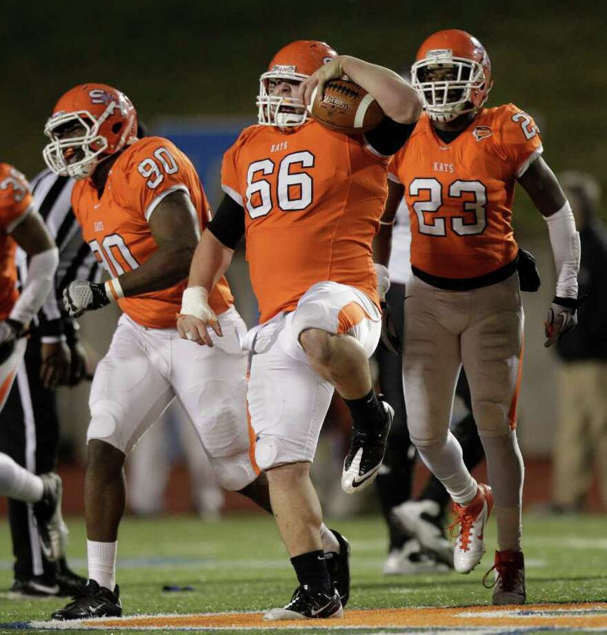 Sam Houston State defensive tackle Gary Lorance (66) celebrates recovering a Montana fumble during the first quarter of an NCAA Football Championship Subdivision semifinal playoff game at Bowers Stadium Friday, Dec. 16, 2011, in Huntsville. Photo: Brett Coomer, Houston Chronicle / © 2011 Houston Chronicle