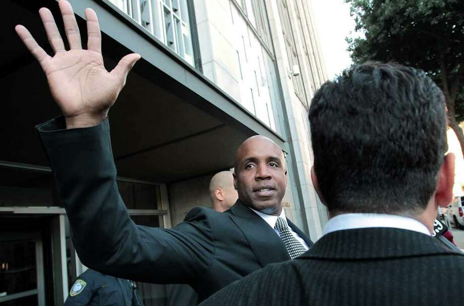 JUSTIN SULLIVAN: GETTY IMAGES NO PLACE LIKE HOME: With a wave of his hand and no comment during or after his sentencing hearing, Barry Bonds leaves federal court Friday to serve 30 days of house arrest Photo: Justin Sullivan / 2011 Getty Images