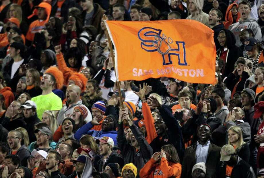 Sam Houston State fans cheer following a SHSU touchdown during the first quarter of an NCAA Football Championship Subdivision semifinal playoff game against Montana at Bowers Stadium Friday, Dec. 16, 2011, in Huntsville. Photo: Brett Coomer, Houston Chronicle / © 2011 Houston Chronicle