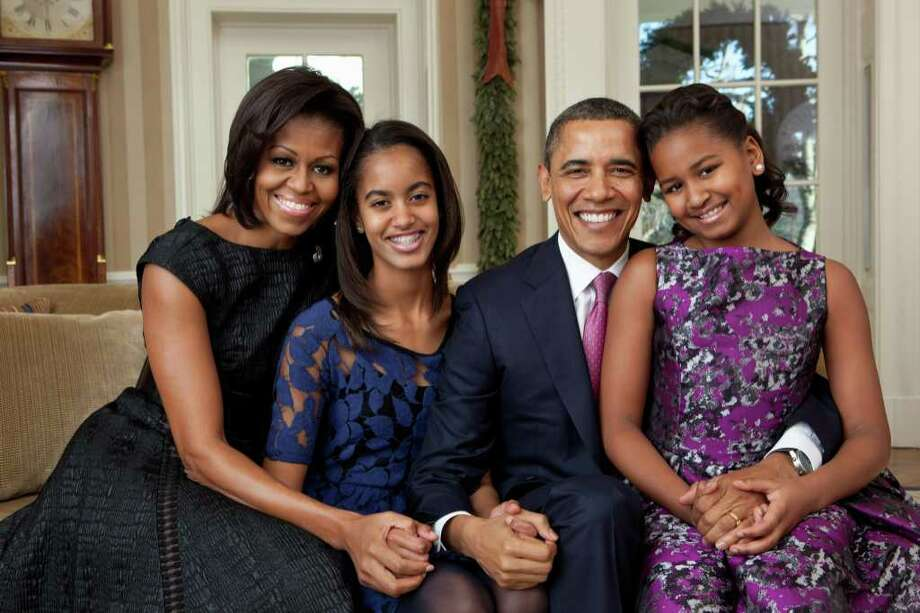 Capturing a moment in time is a wonderful idea but who wants to spend Father's Day sitting for formal portraits. Perhaps a better idea is letting the kids snap shots of dad and each other while doing an activity together.  Photo: Pete Souza, Associated Press / The White House