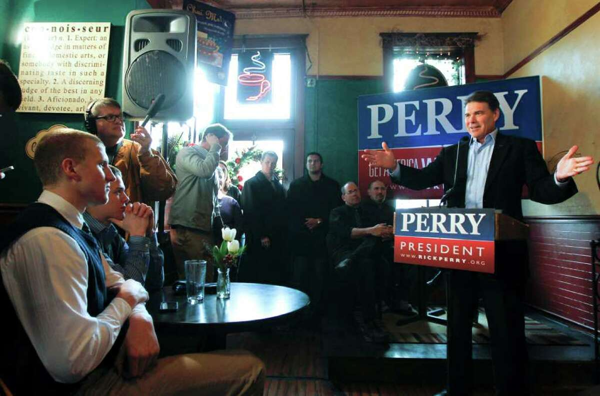 Republican presidential candidate, Texas Gov. Rick Perry speaks during a campaign stop at the Copper Cup Coffee Shop in Cherokee, Iowa, Friday, Dec. 16, 2011. (AP Photo/Chris Carlson)
