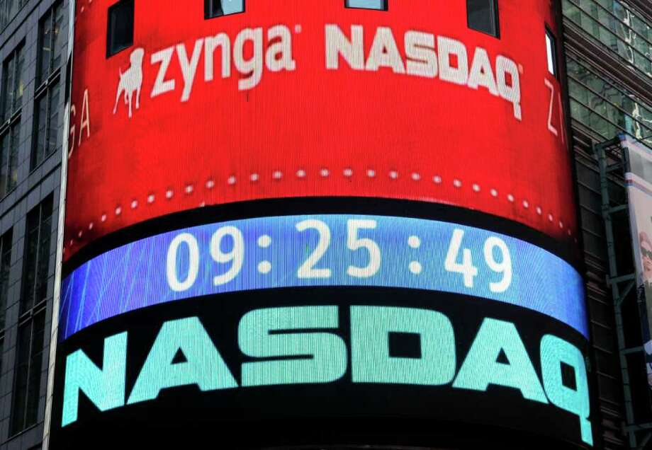 The corporate logo for Zynga is shown on an electronic billboard at the Nasdaq MarketSite, Friday, Dec. 16,  2011 in New York. Stock in the San Francisco company began trading at Nasdaq, Friday following its IPO. (AP Photo/Mark Lennihan) Photo: Mark Lennihan / AP