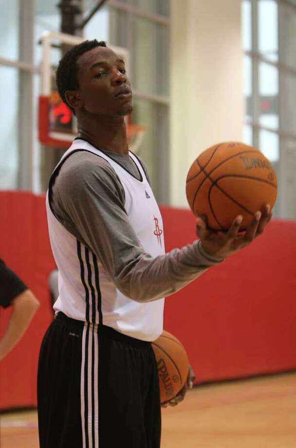 IN HIS HANDS: Rockets center Hasheem Thabeet can put a lot of doubt concerning the team's inexperienced big men to rest with a favorable performance Saturday against the Spurs. Photo: Karen Warren / © 2011 Houston Chronicle