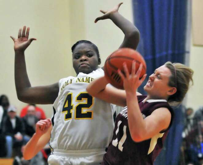 Holy Names'  #42 De'Janaire Deas, left, and  Watervliet's #11 Katelyn Murray during Friday nights' g