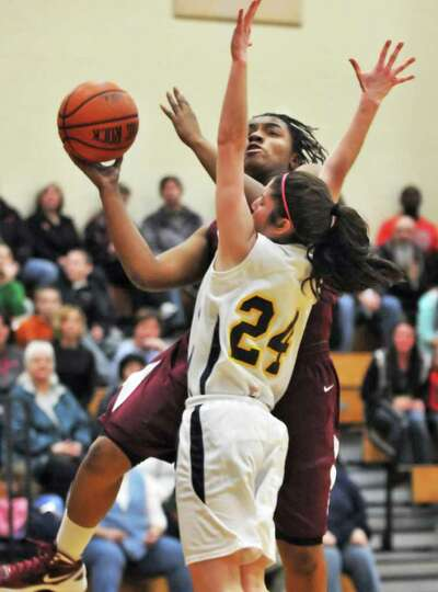Watervliet's #15, LaShana Tolliver goes up for two against Holy Names's #24 Bernadette Jordan during