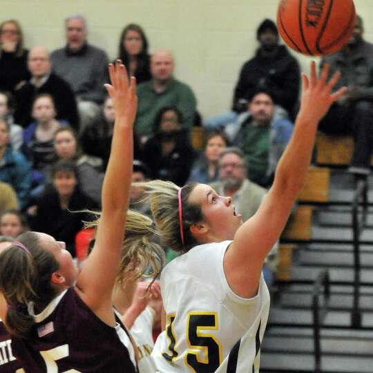 Holy Names'  #15 Christina Spicer, at right, goes to the hoop during Friday nights' game against Wat