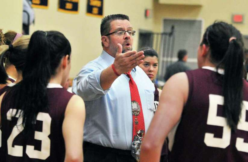 Watervliet head coach Gordie Johnson, center, with players during a time out during their game with