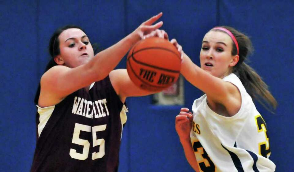 Watervliet's Mikayla Deguire, left,  and Holy Names' Katherine Small fight for the ball during Frida