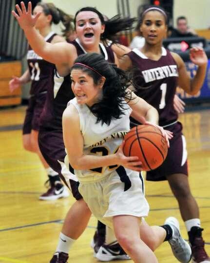 Holy Names' Bernadette Jordan goes to the basket past Watervliet defenders during Friday nights' gam
