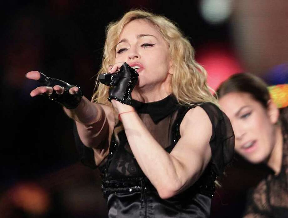 Srdjan Ilic : Associated Press File BIG-TIME CONCERTS: You may decide to support the arts by following Madonna's tour after seeing her performance at the next Super Bowl. Photo: SRDJAN ILIC / AP2009