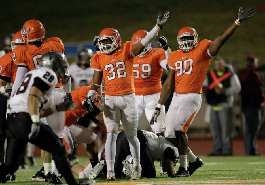 Sam Houston State safety Kenneth Jenkins (32) and defensive end Edward Decambre (90) celebrate a Montana turnover during the first quarter of an NCAA Football Championship Subdivision semifinal playoff game at Bowers Stadium Friday, Dec. 16, 2011, in Huntsville. Photo: Brett Coomer, Houston Chronicle / © 2011 Houston Chronicle