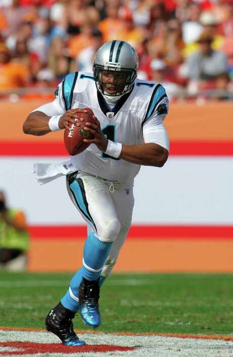Carolina Panthers quarterback Cam Newton (1) scrambles against the Tampa Bay Buccaneers.  The Panthers defeated the Buccaneers 38-19 in an NFL game Sunday, Dec. 4, 2011, in Tampa,Fla. (AP Photo/Margaret Bowles) Photo: Margaret Bowles / FR158735 AP