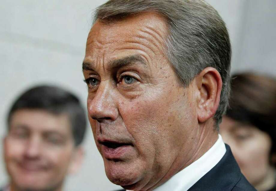 House Speaker John Boehner of Ohio, briefs reporters on Capitol Hill in Washington, Friday, Dec. 16, 2011, after lawmakers from both political parties came together on an 11th-hour deal to keep the government from shutting down.  (AP Photo/J. Scott Applewhite) Photo: J. Scott Applewhite