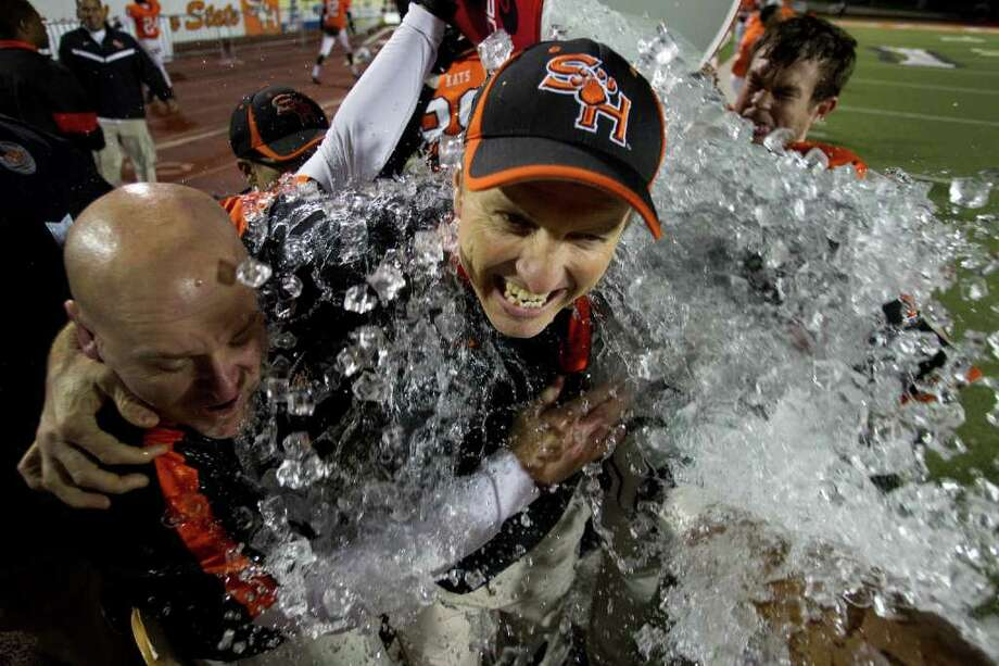 Brett Coomer Photos: Chronicle THE CHILL OF VICTORY: It's splashdown for Sam Houston State coach Willie Fritz, center. A bucket of ice was his reward for guiding the Bearkats to a 31-28 victory over Montana in the FCS semifinals Friday night at Bowers Stadium. Photo: Brett Coomer / © 2011 Houston Chronicle