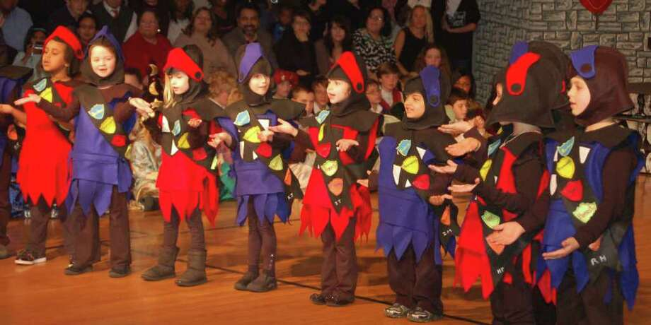 In the medievil Kingdom of Unquowa, the first grade knights were a colorfully outfitted force to be reckoned with. The scene is from the Thursday evening, Dec. 15, 31st annual Winter Festival the Unquowa School. Photo: Contributed Photo / Fairfield Citizen contributed