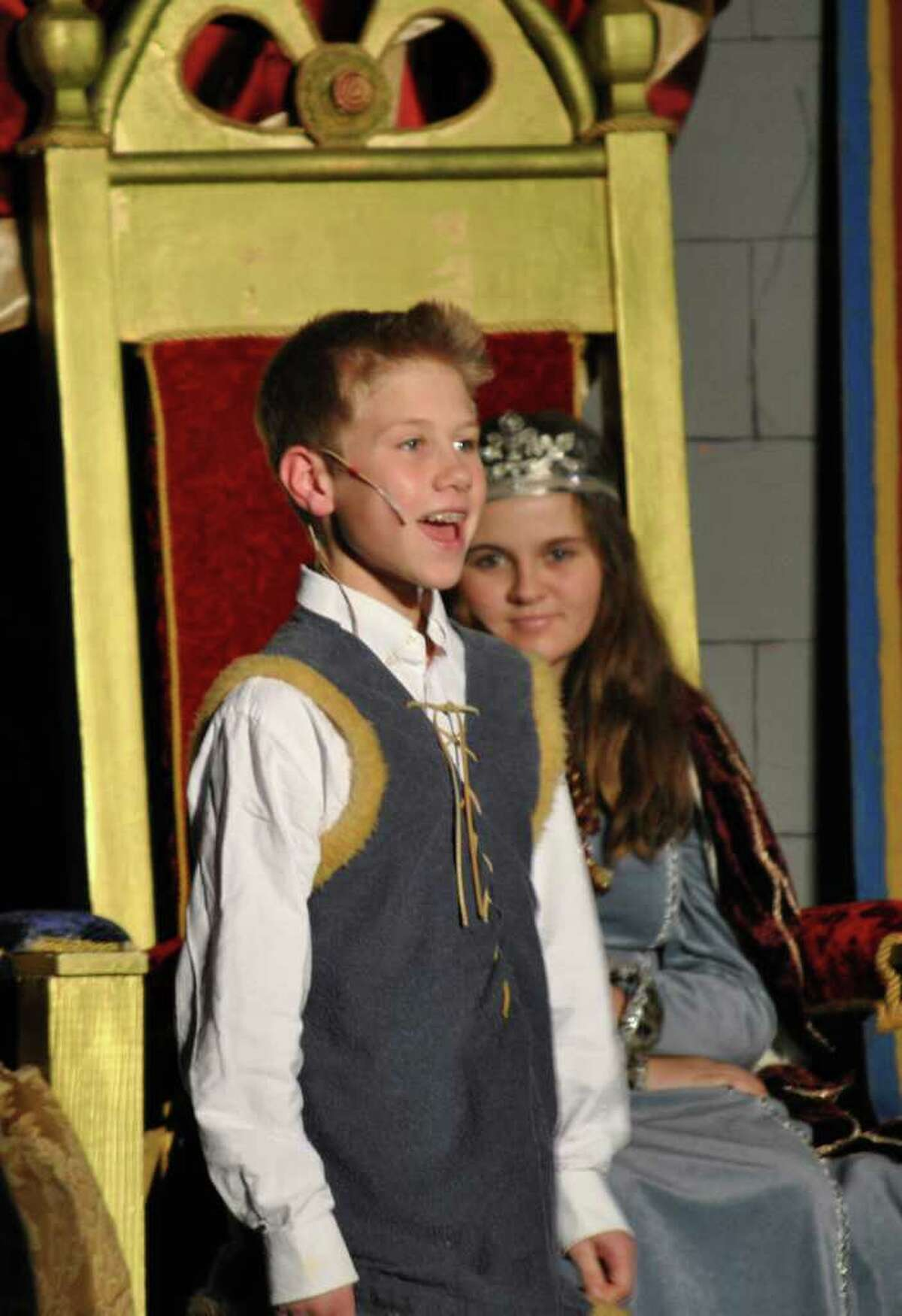 In his role as the prince, James Roland sings while one of the queens, Rebecca Ryan, listens from her golden throne during the Unquoa School's 31st annual Winter Festival.