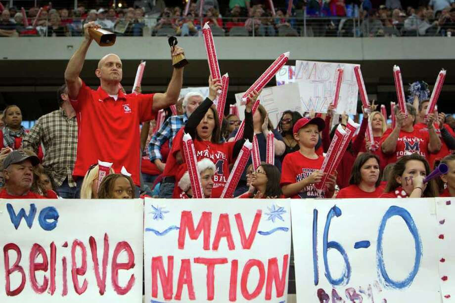 Manvel fans cheer their team during the first quarter of the 4A Div. 2 state championship high school football game against Aledo at Cowboys Stadium on Saturday, Dec. 17, 2011, in Arlington. Photo: Smiley N. Pool, Houston Chronicle / © 2011  Houston Chronicle