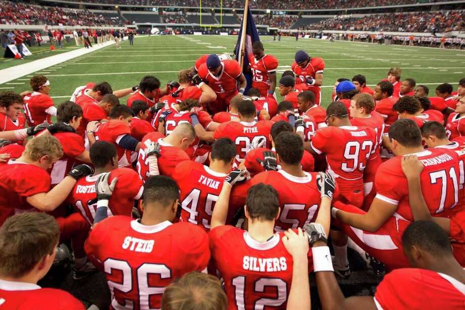 Manvel players huddle in prayer before facing Aledo in the 4A Div. 2 state championship high school football game at Cowboys Stadium on Saturday, Dec. 17, 2011, in Arlington. Photo: Smiley N. Pool, Houston Chronicle / © 2011  Houston Chronicle
