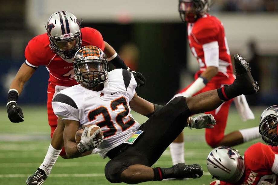 Aledo running back Jonathan Gray (32) is upended by the Manvel defense during the first quarter of the 4A Div. 2 state championship high school football game at Cowboys Stadium on Saturday, Dec. 17, 2011, in Arlington. Photo: Smiley N. Pool, Houston Chronicle / © 2011  Houston Chronicle