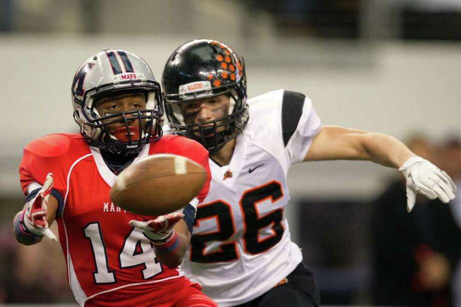 Manvel wide receiver Austin Mennett (14) can't get his hands on a pass as Aledo defensive back James Place (26) gives chase during the second quarter of the 4A Div. 2 state championship high school football game at Cowboys Stadium on Saturday, Dec. 17, 2011, in Arlington. Photo: Smiley N. Pool, Houston Chronicle / © 2011  Houston Chronicle