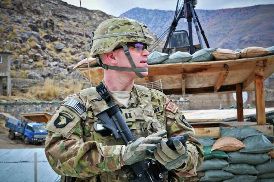 U.S. Army Capt. Jonathan Springer, an active duty artillery officer, uses his iPhone application Tactical Nav at Camp Blessing, Afghanistan, in this February 2011 photo provided to the media. The application Springer built with $30,000 of his savings and a maxed-out credit card a year ago, uses GPS technology and the iPhone's camera to chart coordinates and guide artillery fire. Photographer: Michael Ossa/U.S. Army via Bloomberg EDITOR'S NOTE: EDITORIAL USE ONLY. NO SALES.