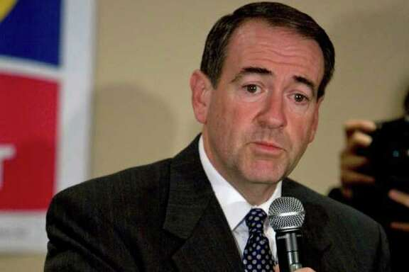 BLOOMBERG FILE LANDSLIDE: Evangelical Christians' support propelled Mike Huckabee to victory in the Iowa caucuses in 2008. Their influence will be large again in 2012.