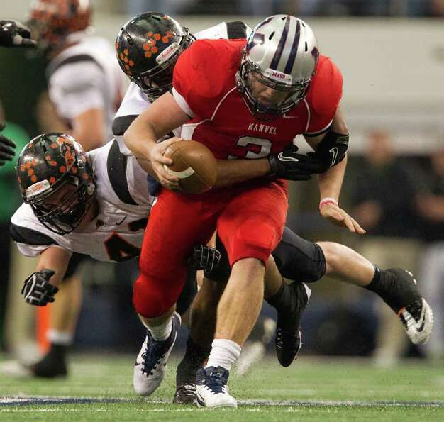 Manvel quarterback Shane McCarley is sacked by Aledo defensive linemen Jared Hinsley (41) and Jaylen