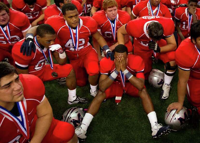 Manvel quarterback Julian Walker is consoled by offensive lineman Cory Klingler after the 4A Div. 2
