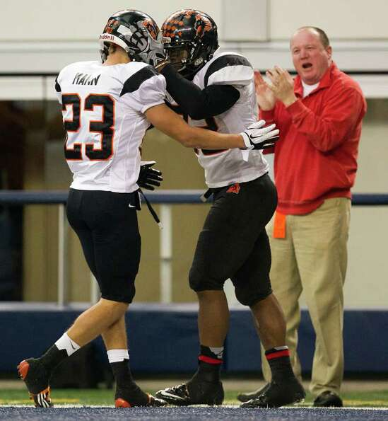 Aledo running back Jonathan Gray (32) celebrates with teammate Michael Mann (23) after scoring on a
