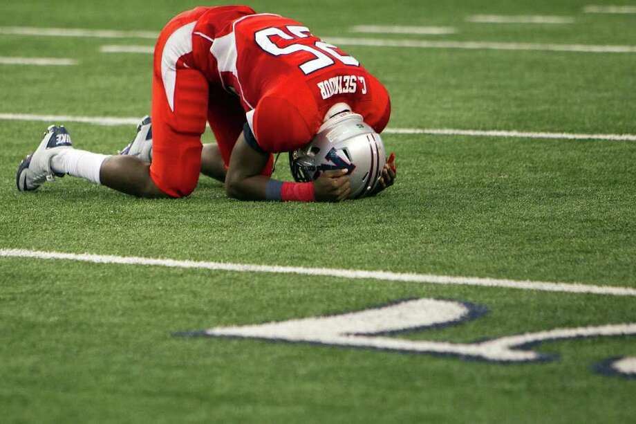 Manvel wide receiver Corey Seymour collapses to the turf as time expires on the 4A Div. 2 state championship high school football game at Cowboys Stadium on Saturday, Dec. 17, 2011, in Arlington.  Aledo won the game 49-28. Photo: Smiley N. Pool, Houston Chronicle / © 2011  Houston Chronicle